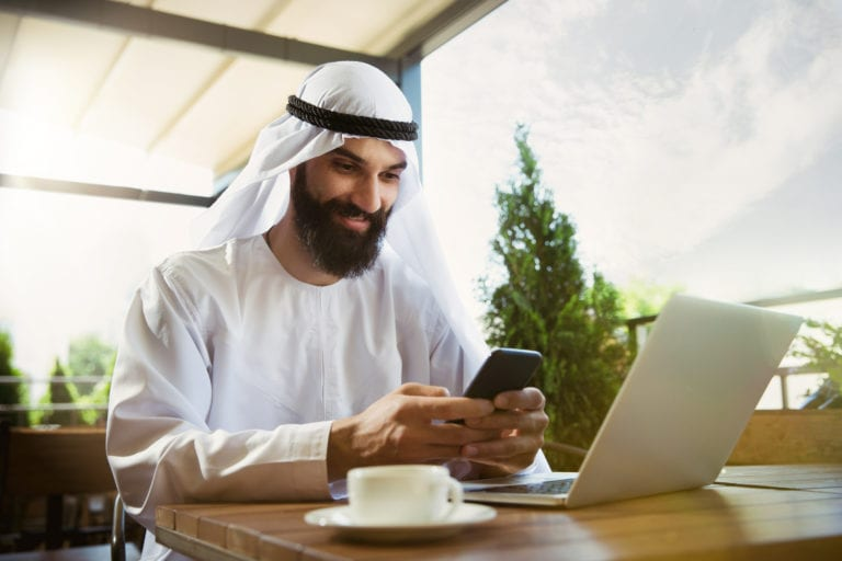 arabian saudi businessman working outdoors ADJS8ZX scaled