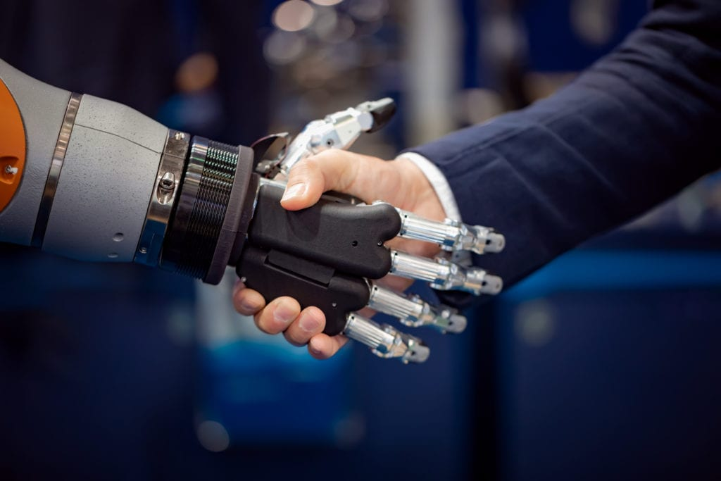 hand of a businessman shaking hands with a GYDH3MX scaled