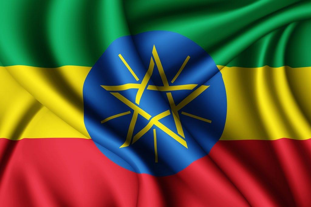 תרגום מסמכים לאמהרית בתמונה דגל אתיופיה פסים רוחביים ירוק צהוב אדום עיגול כחול וכוכב צהוב במרכז